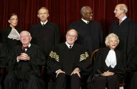 U.S. Supreme Court Justices chat as they gather for an official picture for the first time in nine years at the Supreme Court Building in Washington, December 5, 2003. Pictured in the front row (L-R) Associate Justice John Stevens, Chief Justice of the United States William Rehnquist and Associate Justice Sandra O'Connor. Standing (L-R) are Associate Justices Ruth Ginsburg, David Souter, Clarence Thomas and Stephen Breyer. Other Justices Antonin Scalia and Anthony Kennedy are not pictured.  REUTERS/Jason Reed  REUTERS